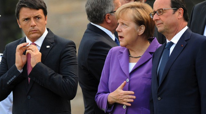 Italian Prime Minister Matteo Renzi (L) adjusts his tie next to German Chancellor Angela Merkel (C) and French President Francois Hollande (R) as they stand with other Heads of State and Government to watch a military fly past in front of a Typhoon fighter jet during the NATO Summit 2014 at the Celtic Manor Resort in Newport, Wales, Britain, 05 September 2014. World leaders from about 60 countries are coming together for a two-day NATO summit taking place from 04-05 September.  ANSA/STEFAN ROUSSEAU / POOL