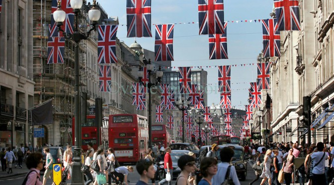 22 April 2011. London, England. London's Regent Street decked out with Union Jack flags  to celebrate the upcoming Royal wedding in the heart of London's West End. Thousands of tourists are packing the shops, hotels and restaurants as the big day draws near.  Photo; Charlie Varley