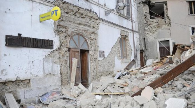 A post office is engulfed by rubbles in Arcuata del Tronto, central Italy, where a 6.1 earthquake struck just after 3:30 a.m., Wednesday, Aug. 24, 2016. The quake was felt across a broad section of central Italy, including the capital Rome where people in homes in the historic center felt a long swaying followed by aftershocks. (ANSA/AP Photo/Sandro Perozzi) [CopyrightNotice: ap]