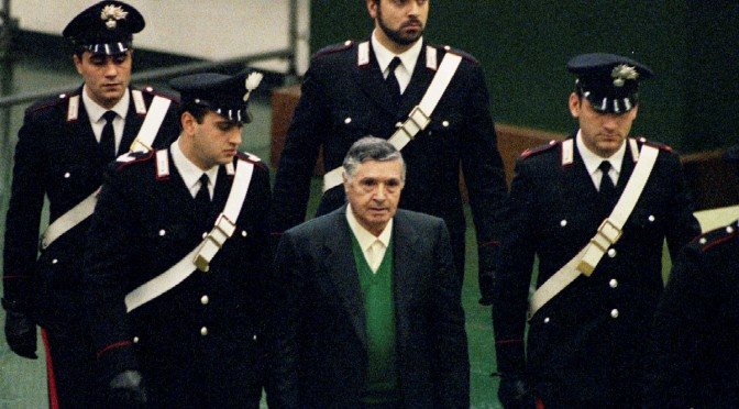 FILE PHOTO: Mafia boss Toto Riina is escorted by Italian Carabinieri officers as he arrives at the court house in Palermo, Italy December 1, 1993. REUTERS/Tony Gentile/File Photo - RTX39983
